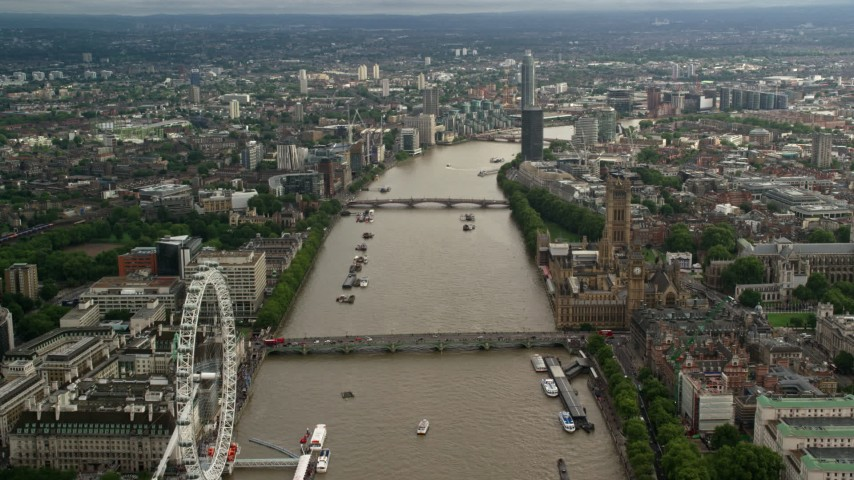 Bridges over the River Thames through London, England Aerial Stock Footage | AX115_122
