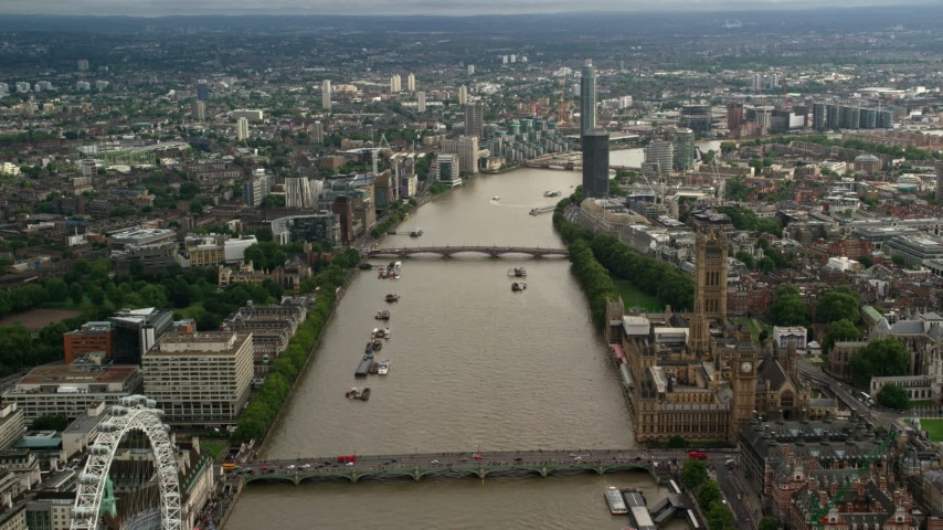 6K stock footage aerial video of flying over bridges spanning the River Thames through London, England Aerial Stock Footage | AX115_122