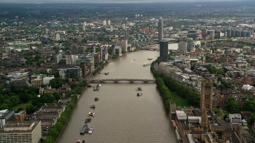 6K stock footage aerial video of approaching Lambeth Bridge spanning the River Thames through London, England Aerial Stock Footage | AX115_123
