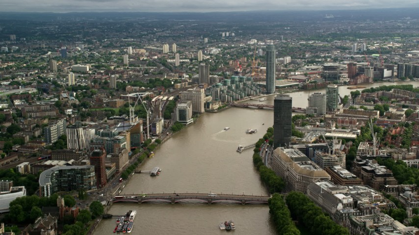 6K stock footage aerial video of Lambeth Bridge spanning the River Thames near MI6 Building in London, England Aerial Stock Footage | AX115_124