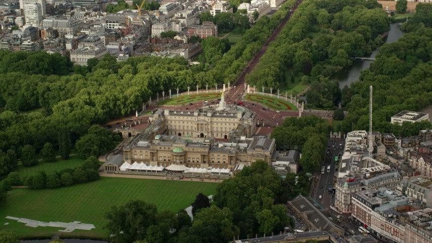 6K stock footage aerial video of orbiting around the back of Buckingham Palace, London, England Aerial Stock Footage | AX115_128