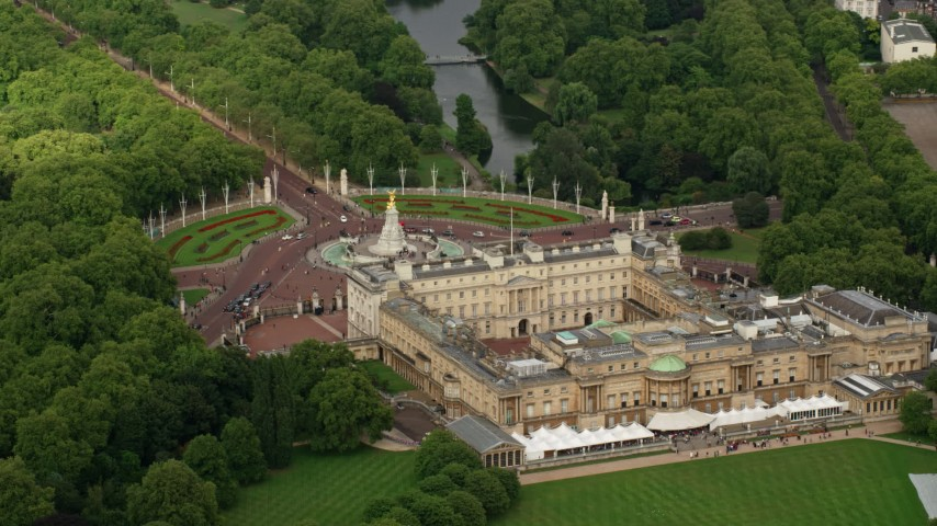 6K stock footage aerial video orbiting Buckingham Palace and Victoria Memorial, London, England Aerial Stock Footage | AX115_130