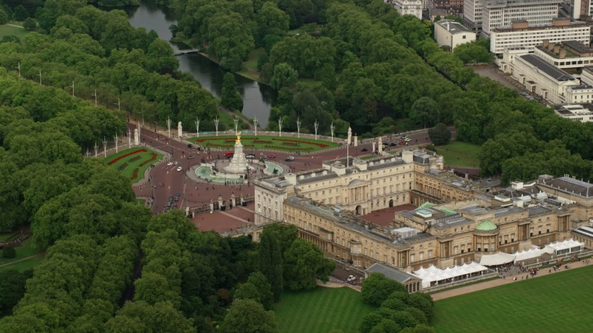 6K stock footage aerial video of orbiting the side of Buckingham Palace, Victoria Memorial in London, England Aerial Stock Footage | AX115_131