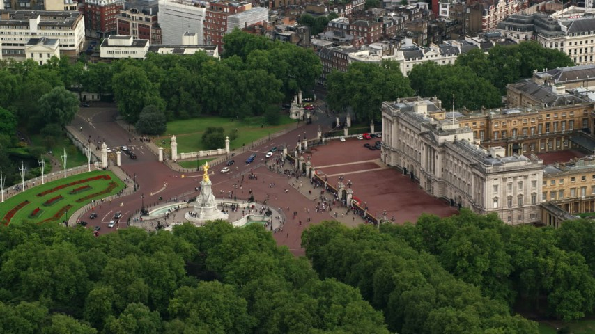 6K stock footage aerial video of an orbit around the Victoria Memorial at Buckingham Palace, London, England Aerial Stock Footage | AX115_134