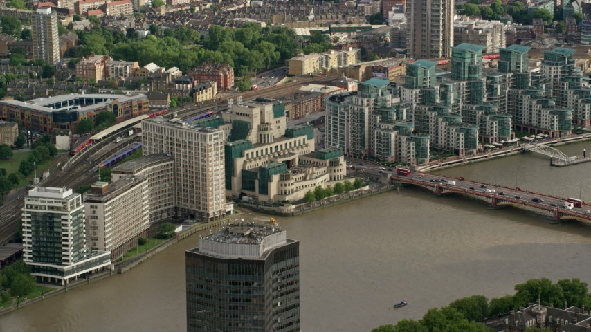 6K stock footage aerial video of MI6 Building across the River Thames, London, England Aerial Stock Footage | AX115_139
