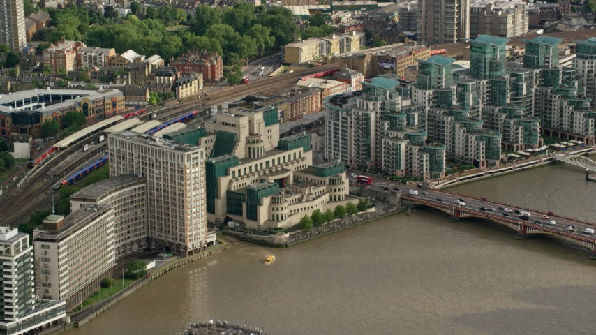 6K stock footage aerial video cross the river to approach the MI6 Building, London, England Aerial Stock Footage | AX115_140
