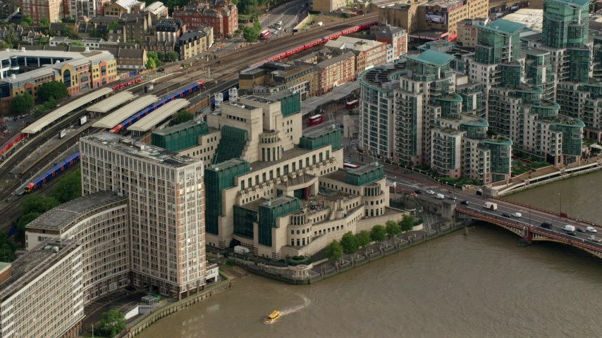 6K stock footage aerial video fly toward the MI6 Building by River Thames, London, England Aerial Stock Footage | AX115_141