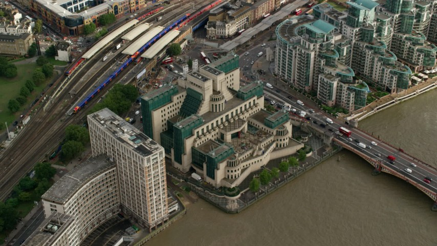 6K stock footage aerial video of tilting to the MI6 Building in London, England Aerial Stock Footage | AX115_142