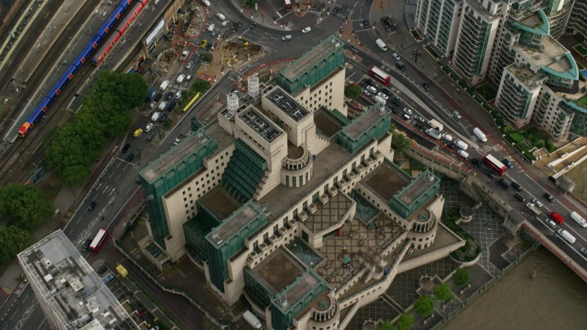 6K stock footage aerial video of tilting to a bird's eye view of the MI6 Building, London, England Aerial Stock Footage | AX115_143