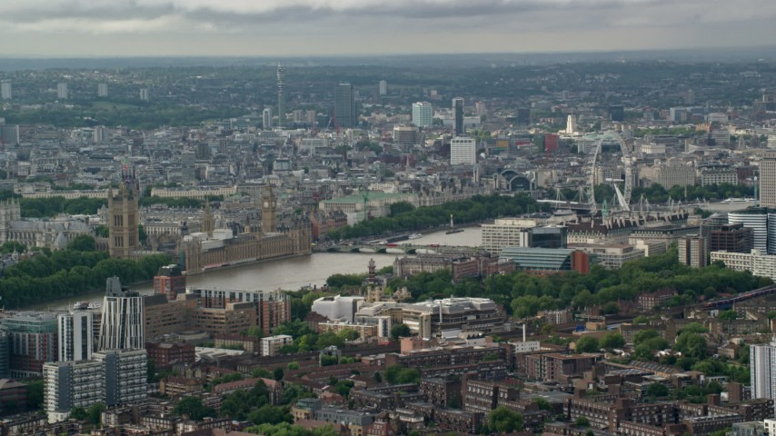 City sprawl with London Eye in foreground, LondonEngland Aerial Stock Footage | AX115_147