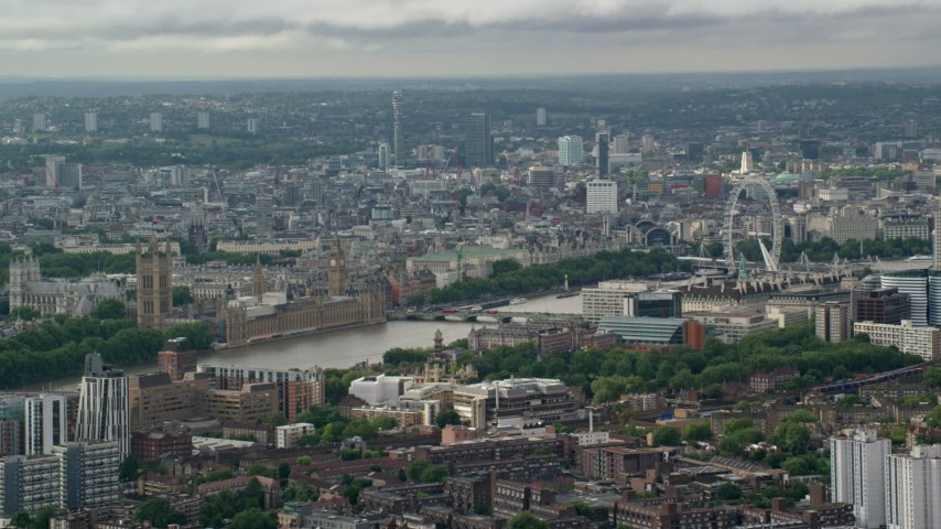 6K stock footage aerial video of city sprawl behind Parliament and London Eye, England Aerial Stock Footage | AX115_147