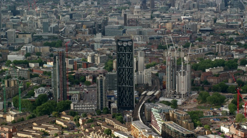 6K stock footage aerial video of Strata Skyscraper among city buildings, London, England Aerial Stock Footage | AX115_148