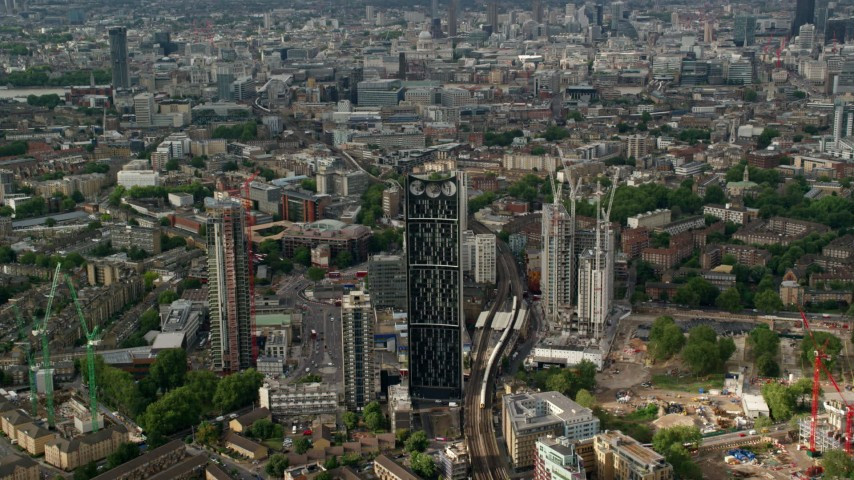 6K stock footage aerial video approach Strata skyscraper against sprawling cityscape, London, England Aerial Stock Footage | AX115_150