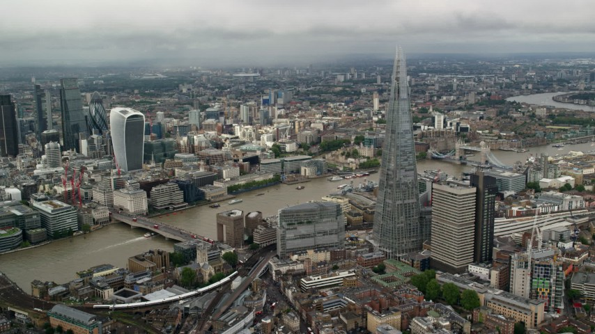6K stock footage aerial video of orbiting The Shard by the River Thames, London, England Aerial Stock Footage | AX115_153