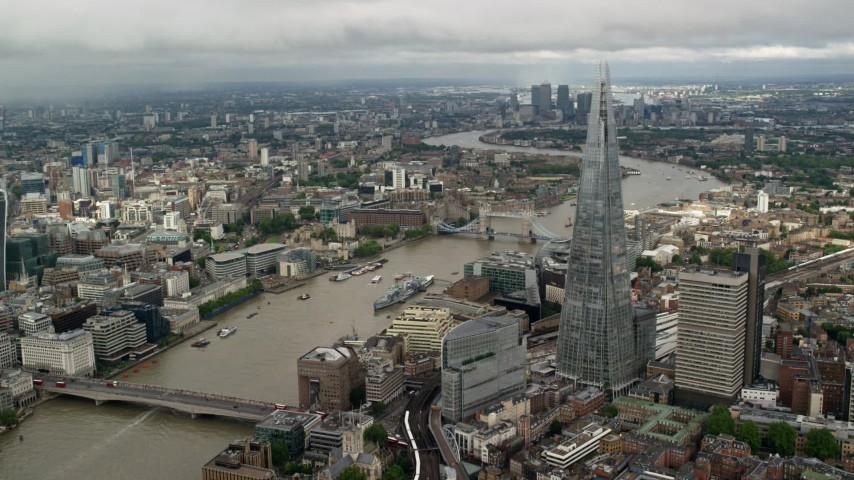 6K stock footage aerial video of orbiting The Shard overlooking the River Thames, London, England Aerial Stock Footage | AX115_154