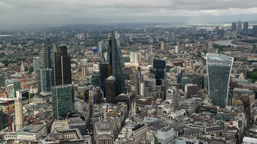 6K stock footage aerial video of orbiting a group of skyscrapers in Central London, England Aerial Stock Footage | AX115_156