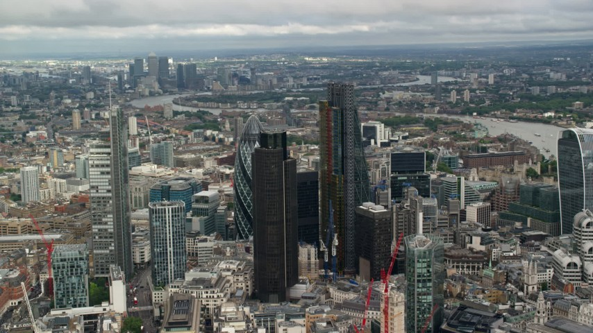 6K stock footage aerial video of an orbit of a group of skyscrapers in Central London, England Aerial Stock Footage | AX115_158