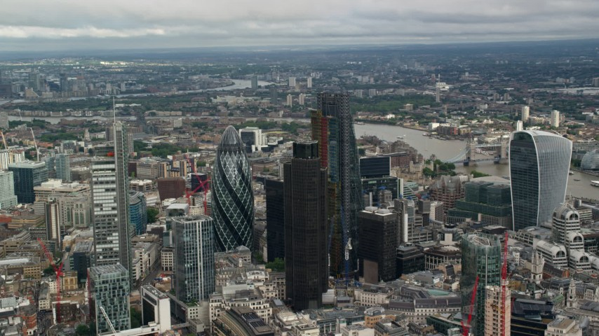6K stock footage aerial video of orbiting skyscrapers in Central London, England Aerial Stock Footage | AX115_159