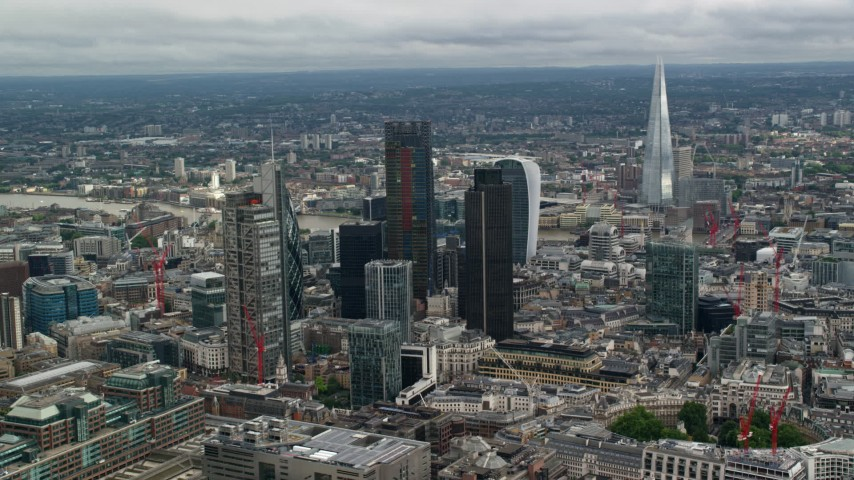6K stock footage aerial video of The Shard behind tall skyscrapers and cityscape, Central London, England Aerial Stock Footage | AX115_161