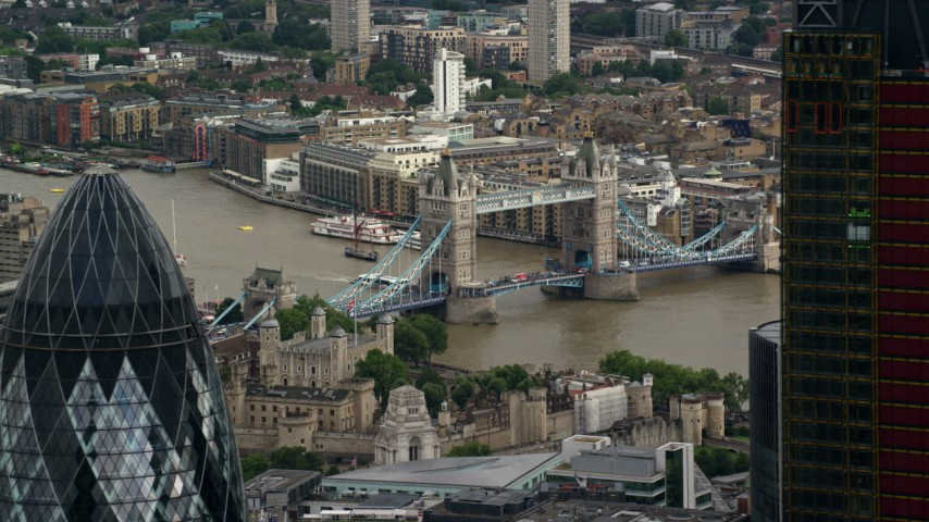 6K stock footage aerial video flyby The Gherkin with view of Tower of London and Tower Bridge, England Aerial Stock Footage | AX115_163