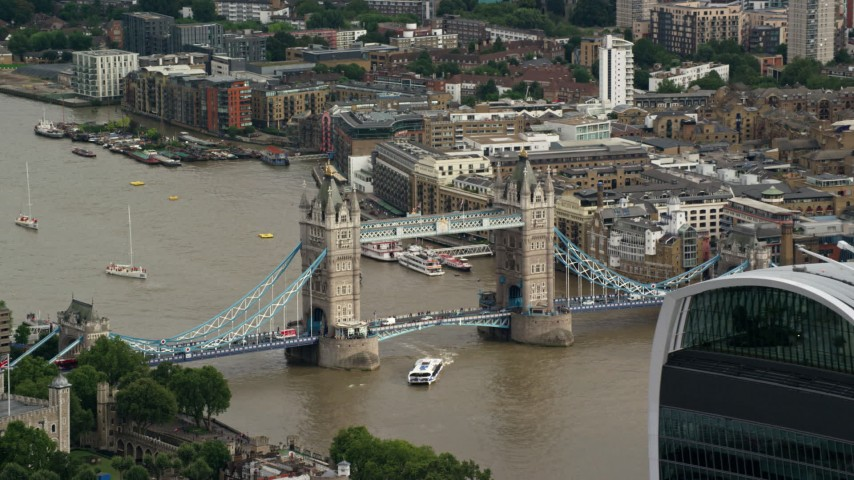 6K stock footage aerial video of the Tower Bridge in London, England Aerial Stock Footage | AX115_165