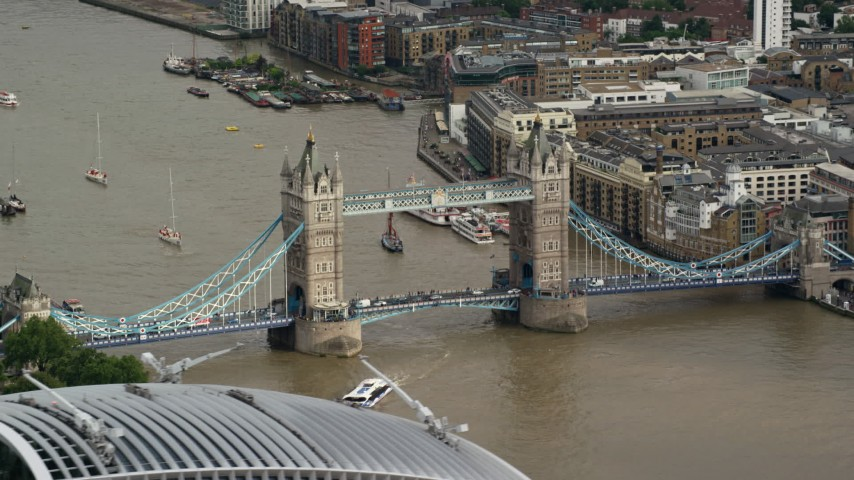 6K aerial video of a view of the Tower Bridge spanning River Thames, London, England Aerial Stock Footage | AX115_166