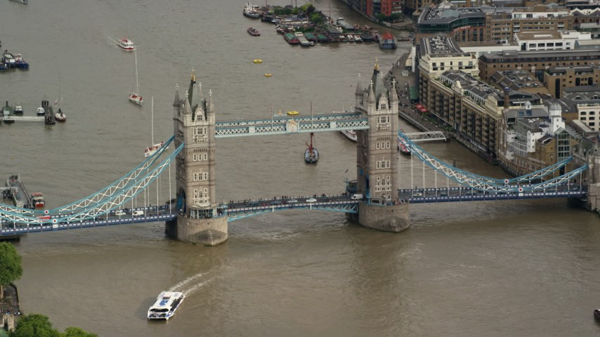 6K aerial video of orbiting Tower Bridge and River Thames, London, England Aerial Stock Footage | AX115_167