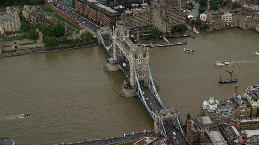 6K aerial video of orbiting the Tower Bridge spanning River Thames, London, England Aerial Stock Footage | AX115_172