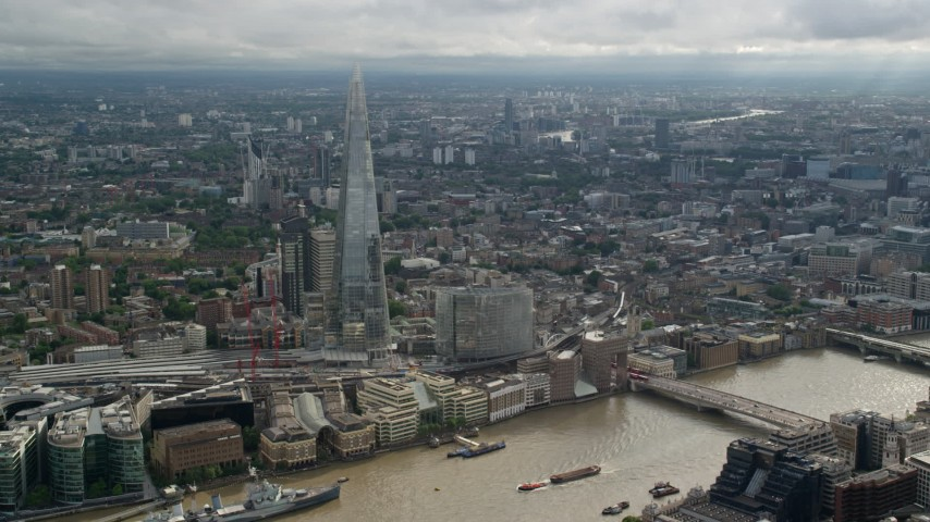 6K stock footage aerial video of a wide orbit of The Shard and cityscape, London, England Aerial Stock Footage | AX115_177