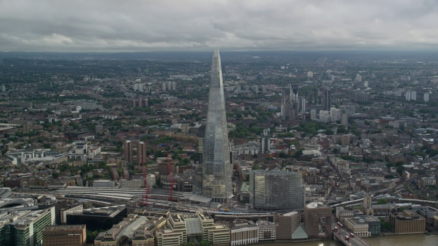 6K stock footage aerial video of orbiting The Shard overlooking cityscape, London, England Aerial Stock Footage | AX115_179