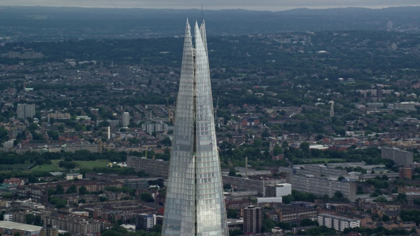 6K stock footage aerial video of orbiting the top of The Shard, London, England Aerial Stock Footage   AX115_180