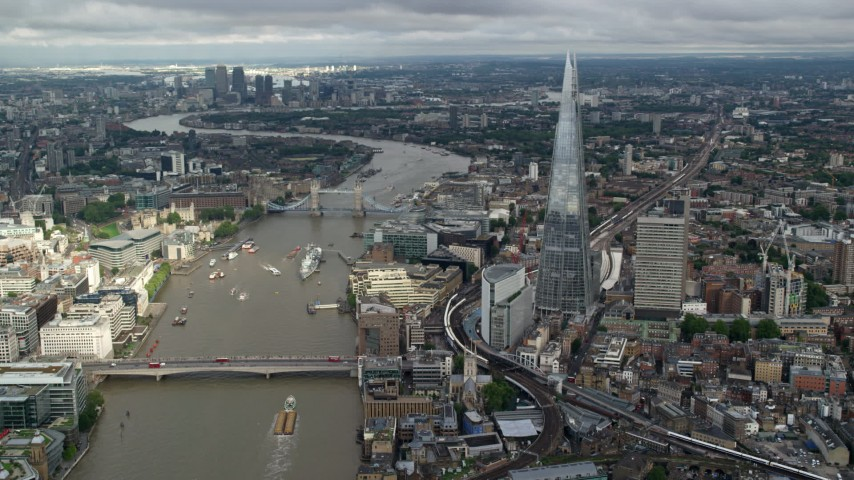 6K stock footage aerial video of The Shard, and Tower Bridge over the River Thames, London, England Aerial Stock Footage | AX115_184