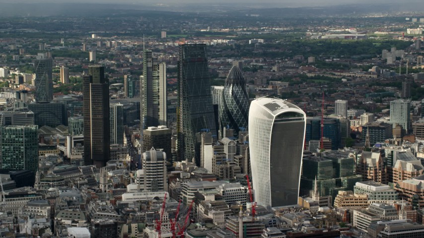 6K stock footage aerial video of approaching Central London skyscrapers from River Thames, England Aerial Stock Footage | AX115_186