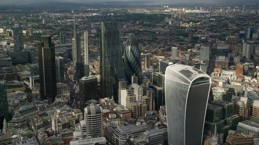6K stock footage aerial video of approaching The Gherkin and nearby skyscrapers, Central London, England Aerial Stock Footage | AX115_188