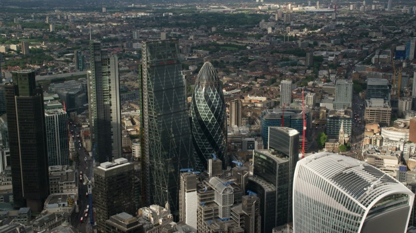 6K stock footage aerial video approach The Gherkin and Leadenhall Building skyscrapers, Central London, England Aerial Stock Footage AX115_189 | Axiom Images