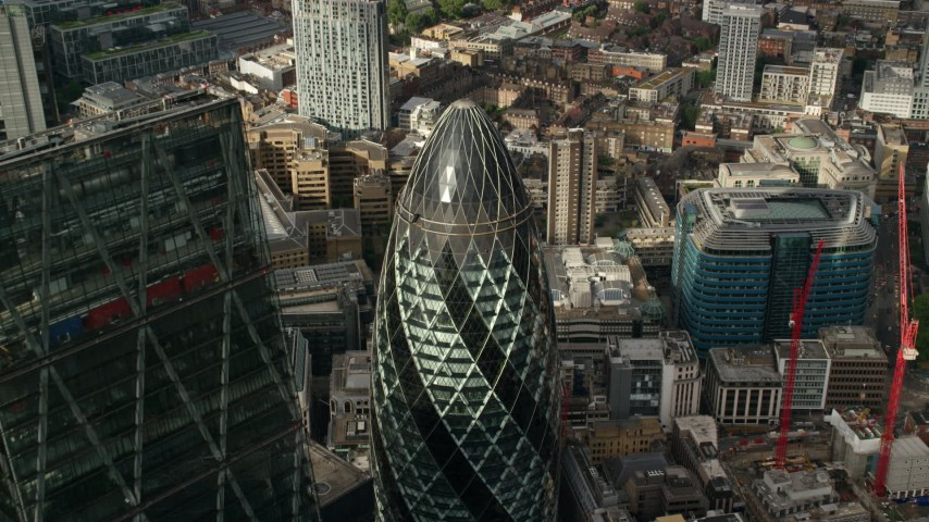 6K stock footage aerial video tilt to the top of The Gherkin during approach, Central London, England Aerial Stock Footage | AX115_190