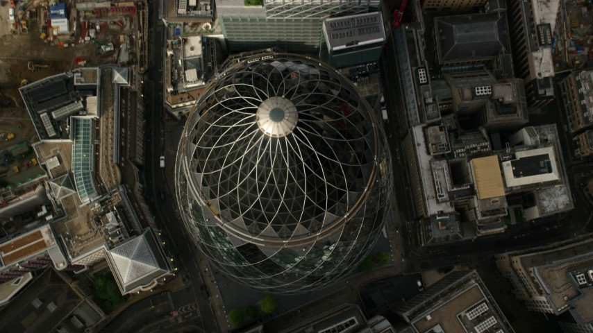 6K stock footage aerial video tilt to bird's eye view of The Gherkin skyscraper, Central London, England Aerial Stock Footage | AX115_191