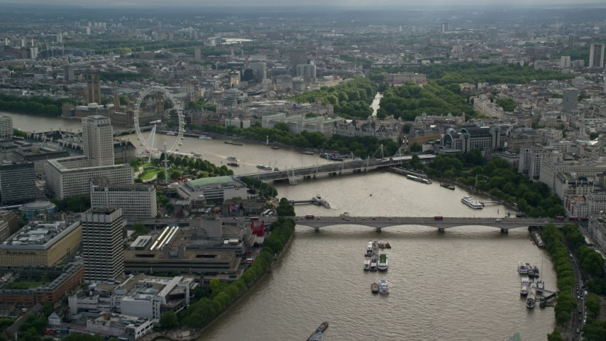 6K stock footage aerial video of the London Eye, and bridges spanning the Thames in London, England Aerial Stock Footage | AX115_195