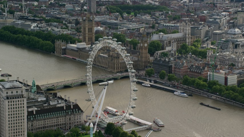 6K stock footage aerial video approach the London Eye beside the River Thames, near Parliament, England Aerial Stock Footage | AX115_196