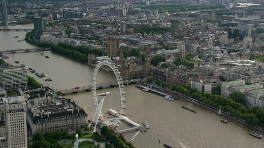 London Eye, Westminster Bridge, Big Ben and Parliament along the Thames, England Aerial Stock Footage | AX115_197