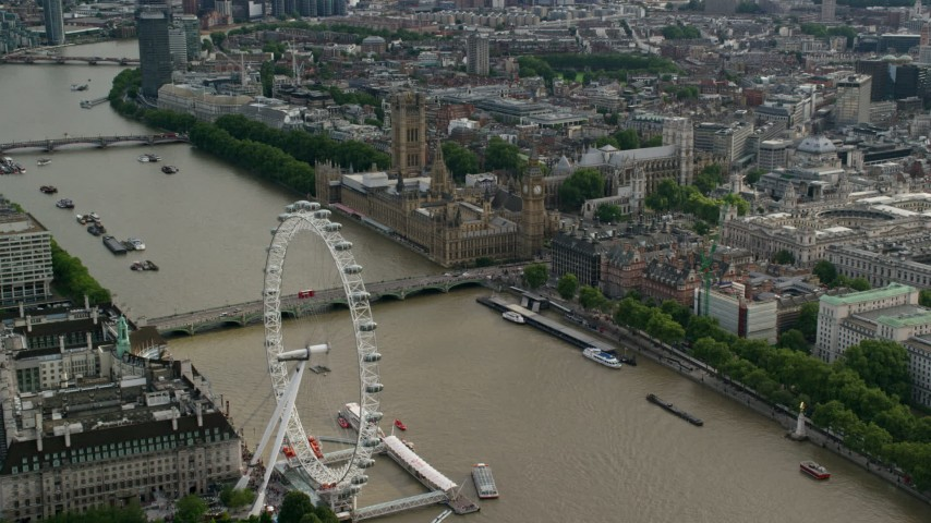 6K stock footage aerial video of London Eye, Westminster Bridge, Big Ben and Parliament by the Thames, England Aerial Stock Footage | AX115_197