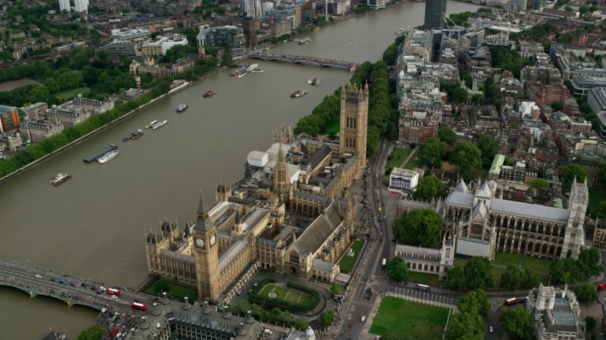6K stock footage aerial video orbiting Big Ben, Parliament and Westminster Abbey by the Thames in London, England Aerial Stock Footage | AX115_199