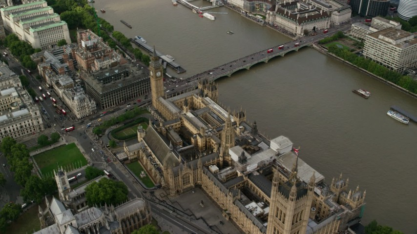 6K stock footage aerial video orbit above Big Ben and Parliament beside the River Thames, London, England Aerial Stock Footage | AX115_201