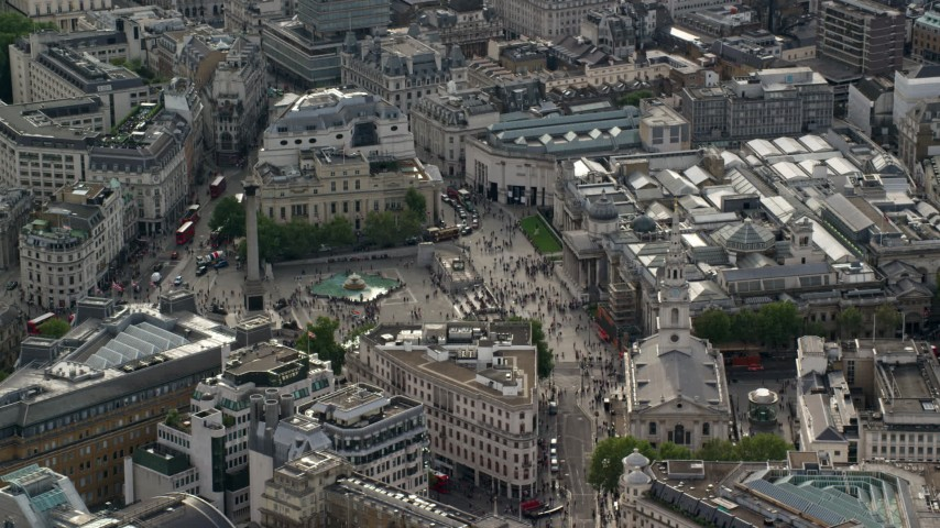 6K stock footage aerial video orbiting Trafalgar Square and Canada House, London, England Aerial Stock Footage | AX115_205