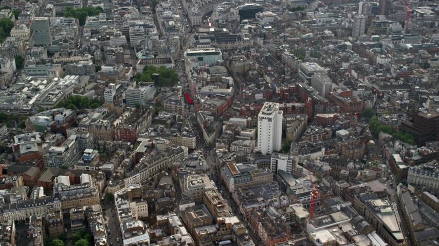 6K stock footage aerial video of city buildings surrounding Long Acre Charing Cross Road, London, England Aerial Stock Footage | AX115_207