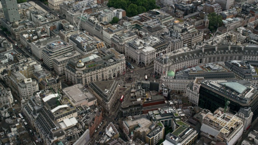 6K stock footage aerial video of flying by Piccadilly Circus with traffic and tourists, London, England Aerial Stock Footage | AX115_210