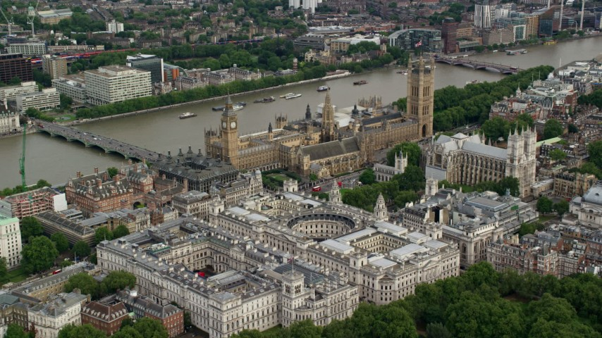 6K stock footage aerial video approach Big Ben, Parliament and government offices on the Thames, London, England Aerial Stock Footage | AX115_212
