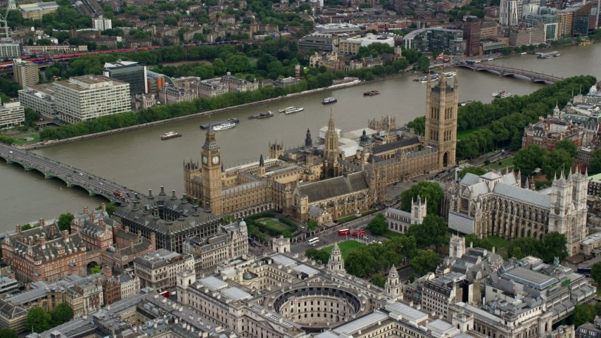 6K stock footage aerial video of approaching Big Ben and Parliament along the Thames, London, England Aerial Stock Footage | AX115_213