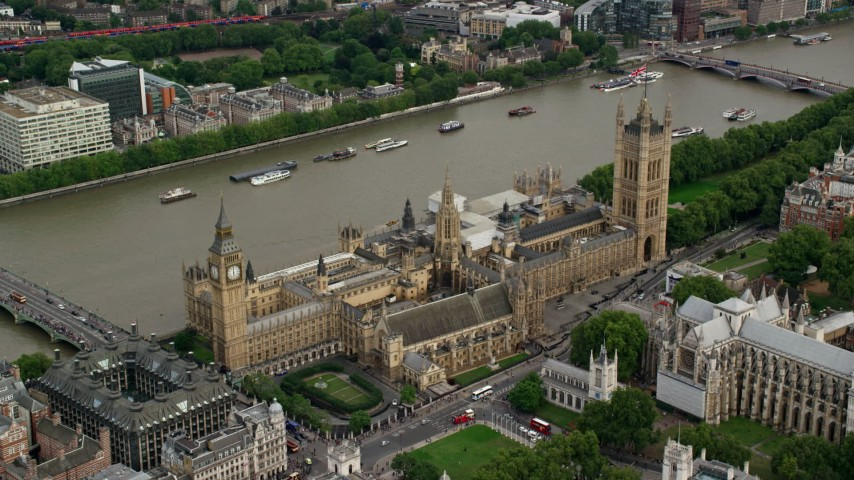 Approach and tilt down on Big Ben and Parliament, London England Aerial Stock Footage | AX115_214