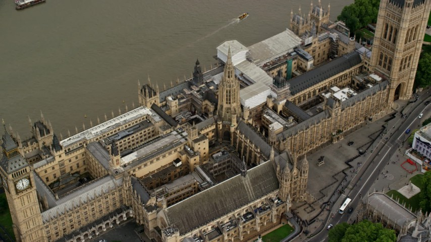 6K stock footage aerial video tilt to bird's eye view of the British Parliament, London, England Aerial Stock Footage | AX115_215